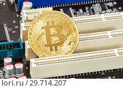 Купить «Coins of Cryptocurrency Bitcoin lying over electronic computer component», фото № 29714207, снято 10 марта 2018 г. (c) FotograFF / Фотобанк Лори