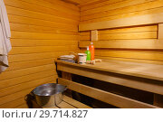 Купить «Fragment of the interior of a small modern Russian banya with some bath accessories», фото № 29714827, снято 12 января 2019 г. (c) Евгений Харитонов / Фотобанк Лори