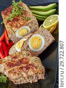 Купить «Egg Stuffed Meatloaf, top view, close up», фото № 29722807, снято 5 января 2019 г. (c) Oksana Zh / Фотобанк Лори