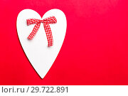 Valentine's day holiday, mother's day, March 8, wedding invitation. Symbol of love white wooden heart on a red background with empty space for text. Стоковое фото, фотограф Светлана Евграфова / Фотобанк Лори