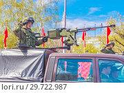"""Купить «Russia, Samara, May 2018: Army jeeps UAZ """"Gusar"""" with a heavy machine gun at the top of a city street.», фото № 29722987, снято 5 мая 2018 г. (c) Акиньшин Владимир / Фотобанк Лори"""