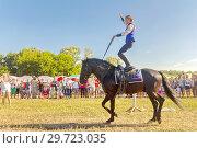 Купить «Russia, Samara, July, 2018: a Cossack girl rides a horse and performs tricks.», фото № 29723035, снято 29 июля 2018 г. (c) Акиньшин Владимир / Фотобанк Лори