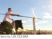 Купить «Russia, Samara, July, 2018: The Cossack rides a horse and performs tricks. Possession of pike.», фото № 29723043, снято 29 июля 2018 г. (c) Акиньшин Владимир / Фотобанк Лори