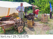 Купить «Russia, Samara, July, 2018: Blacksmithing workshop. Ethno-historical festival with the reconstruction of the battle of 1391 (Timur and Tokhtamysh)», фото № 29723075, снято 29 июля 2018 г. (c) Акиньшин Владимир / Фотобанк Лори