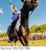 Купить «Russia, Samara, July, 2018: a Cossack girl rides a horse and performs tricks.», фото № 29723199, снято 29 июля 2018 г. (c) Акиньшин Владимир / Фотобанк Лори
