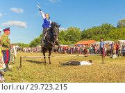 Купить «Russia, Samara, July, 2018: a Cossack girl rides a horse and performs tricks.», фото № 29723215, снято 29 июля 2018 г. (c) Акиньшин Владимир / Фотобанк Лори
