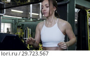 Купить «Pretty Young Woman Athlete In Sportswear Accelerated The Speed», видеоролик № 29723567, снято 20 мая 2019 г. (c) Pavel Biryukov / Фотобанк Лори