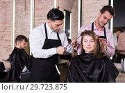 Купить «Two hairdressers making hairstyle for female client», фото № 29723875, снято 5 марта 2018 г. (c) Яков Филимонов / Фотобанк Лори
