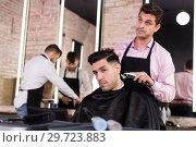 Купить «Hairdresser cutting hair of male with electric clipper», фото № 29723883, снято 5 марта 2018 г. (c) Яков Филимонов / Фотобанк Лори