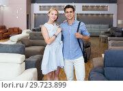 Купить «Happy of the purchase of a new sofa in shop», фото № 29723899, снято 19 июня 2017 г. (c) Яков Филимонов / Фотобанк Лори