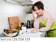 Купить «Frustrated woman crying over banking papers», фото № 29724131, снято 19 января 2019 г. (c) Яков Филимонов / Фотобанк Лори