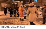 Купить «RUSSIA, KAZAN. 31-12-2018: New Year celebration. People in costumes dancing traditional dances on the streets», видеоролик № 29724623, снято 22 июля 2019 г. (c) Константин Шишкин / Фотобанк Лори