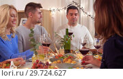 Купить «happy family having dinner party at home», видеоролик № 29724627, снято 7 января 2019 г. (c) Syda Productions / Фотобанк Лори