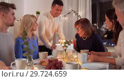 Купить «happy family having birthday party at home», видеоролик № 29724659, снято 7 января 2019 г. (c) Syda Productions / Фотобанк Лори