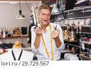 Dressmaker expressing positive emotions. Стоковое фото, фотограф Яков Филимонов / Фотобанк Лори