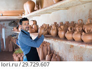 Купить «Smiling male sculptor in pottery atelier», фото № 29729607, снято 27 июня 2019 г. (c) Яков Филимонов / Фотобанк Лори