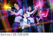 Купить «Parents and children playing laser tag in beams», фото № 29729635, снято 6 июня 2018 г. (c) Яков Филимонов / Фотобанк Лори