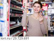 Купить «Young female searching for reliable lipstick», фото № 29729691, снято 21 февраля 2017 г. (c) Яков Филимонов / Фотобанк Лори