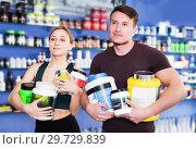 Купить «Athletic couple with sport food», фото № 29729839, снято 12 апреля 2018 г. (c) Яков Филимонов / Фотобанк Лори