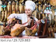 Купить «woman cutting dried ham», фото № 29729883, снято 21 августа 2019 г. (c) Яков Филимонов / Фотобанк Лори