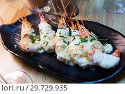 Купить «Baked tasty prawns with parmesan cheese and greens at plate», фото № 29729935, снято 20 ноября 2019 г. (c) Яков Филимонов / Фотобанк Лори
