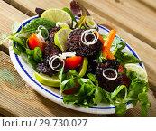Купить «Prepared tasty blood sausage with lettuce and lemon served at plate», фото № 29730027, снято 25 августа 2018 г. (c) Яков Филимонов / Фотобанк Лори