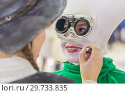 Купить «Russia, Samara, February 2018: the festival of plasticine rain. Portreys girls in fabulous costumes. One corrects the makeup of the other.», фото № 29733835, снято 23 февраля 2018 г. (c) Акиньшин Владимир / Фотобанк Лори