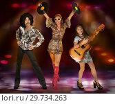 Купить «Disco family perform on stage», фото № 29734263, снято 25 декабря 2018 г. (c) Алексей Кузнецов / Фотобанк Лори