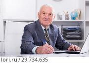Купить «Man working productively», фото № 29734635, снято 21 января 2019 г. (c) Яков Филимонов / Фотобанк Лори