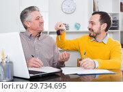 Купить «Mature man sign car purchase contract», фото № 29734695, снято 22 января 2019 г. (c) Яков Филимонов / Фотобанк Лори