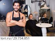 Купить «Portrait of sexy adult man hairdresser standing», фото № 29734851, снято 18 января 2019 г. (c) Яков Филимонов / Фотобанк Лори