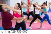 Купить «Young women are doing self-defence-karate moves», фото № 29735007, снято 8 октября 2017 г. (c) Яков Филимонов / Фотобанк Лори