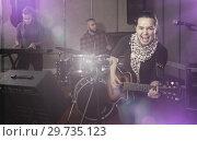 Купить «excited girl rock singer with guitar during rehearsal», фото № 29735123, снято 26 октября 2018 г. (c) Яков Филимонов / Фотобанк Лори