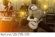 Купить «excited girl rock singer with guitar during rehearsal», фото № 29735131, снято 26 октября 2018 г. (c) Яков Филимонов / Фотобанк Лори