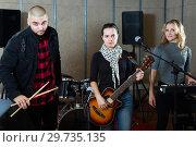 Купить «Young guitarist, drummer and keyboardist», фото № 29735135, снято 26 октября 2018 г. (c) Яков Филимонов / Фотобанк Лори