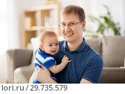 Купить «happy baby boy with father at home», фото № 29735579, снято 5 мая 2018 г. (c) Syda Productions / Фотобанк Лори