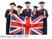 Купить «graduate students with diplomas and british flag», фото № 29735719, снято 10 ноября 2018 г. (c) Syda Productions / Фотобанк Лори