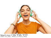 Купить «happy young woman or teenage girl with headphones», фото № 29735727, снято 10 ноября 2018 г. (c) Syda Productions / Фотобанк Лори
