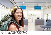 Купить «young woman with backpack over airport terminal», фото № 29735767, снято 25 июля 2015 г. (c) Syda Productions / Фотобанк Лори