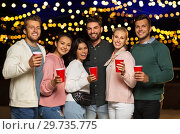 Купить «friends with party cups on rooftop at night», фото № 29735775, снято 2 сентября 2018 г. (c) Syda Productions / Фотобанк Лори