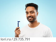 Купить «indian man shaving beard with razor blade», фото № 29735791, снято 27 октября 2018 г. (c) Syda Productions / Фотобанк Лори