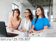 Купить «businesswomen with laptop working at office», фото № 29735807, снято 17 марта 2018 г. (c) Syda Productions / Фотобанк Лори
