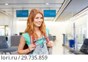 Купить «young woman with backpack over airport terminal», фото № 29735859, снято 25 июля 2015 г. (c) Syda Productions / Фотобанк Лори