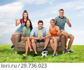 Купить «friends or soccer fans with ball and drinks», фото № 29736023, снято 30 июня 2018 г. (c) Syda Productions / Фотобанк Лори