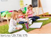 Купить «children drawing and making crafts at home», фото № 29736175, снято 15 октября 2017 г. (c) Syda Productions / Фотобанк Лори