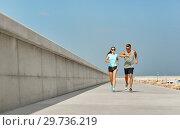 Купить «couple in sports clothes running outdoors», фото № 29736219, снято 1 августа 2018 г. (c) Syda Productions / Фотобанк Лори