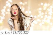 Купить «happy young woman or teen girl in fancy dress», фото № 29736323, снято 31 октября 2015 г. (c) Syda Productions / Фотобанк Лори