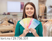 Купить «woman with color swatches at clothing store», фото № 29736331, снято 19 февраля 2016 г. (c) Syda Productions / Фотобанк Лори