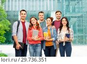 Купить «group of students over university background», фото № 29736351, снято 10 ноября 2018 г. (c) Syda Productions / Фотобанк Лори