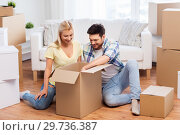 Купить «happy couple unpacking boxes at new home», фото № 29736387, снято 25 февраля 2016 г. (c) Syda Productions / Фотобанк Лори